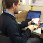 volunteer scanning books for online book sale