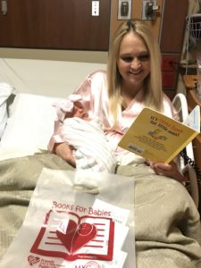 New mom Rachael reading to her daughter Evalyn
