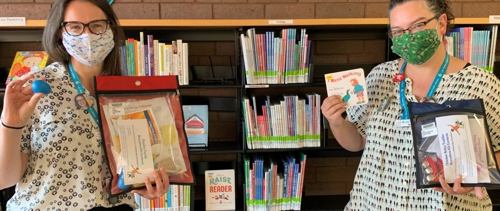 Library Staff displaying October Storytime Kits