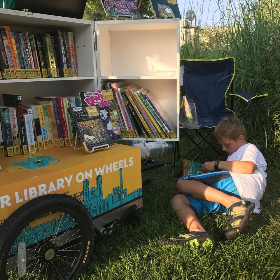 boy reading in grass
