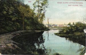 The front of a postcard sent from Eau Claire to Nobleton, Wisconson, in July 1907. The photo shows the road along Little Niagara.