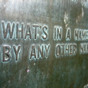 """Photograph of a bronze plaque that contains the text """"What's in a name? That which we call a rose By any other word would smell as sweet."""""""