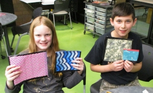 Two middle school kids with their craft projects