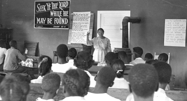 Rosa Parks at the front of a classroom speaking to students