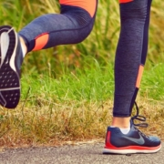 Photo depicts joggers feet in motion